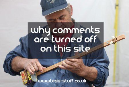 man playing a guitar made of a spam tin